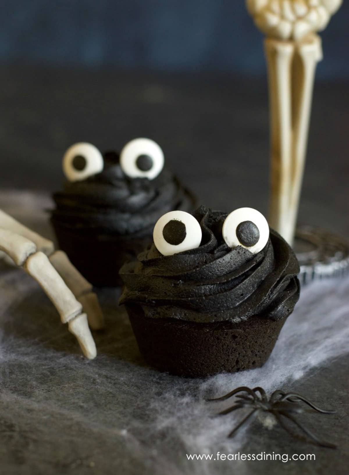 black cupcakes with large googly eyes for Halloween
