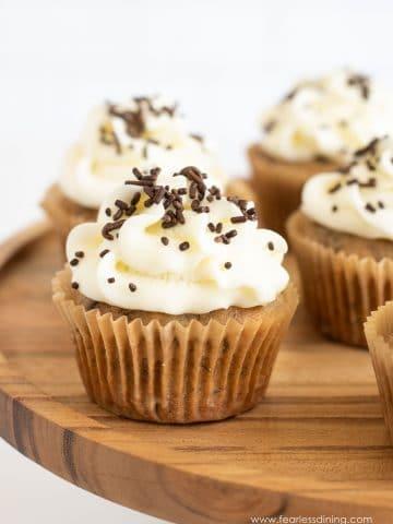 gluten free banana cupcakes on a wooden tray