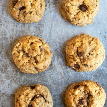 baked chocolate chip hazelnut cookies on a cookie sheet
