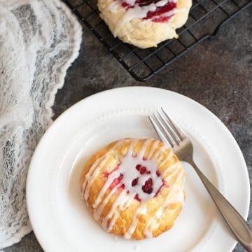 a raspberry kolache on a plate