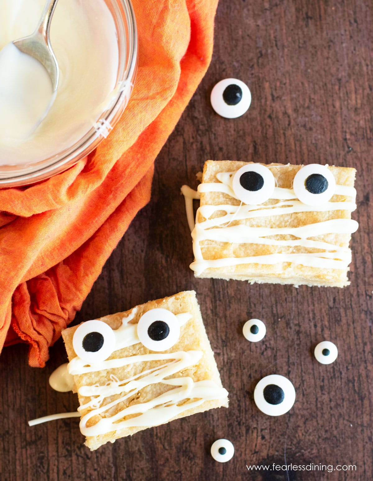 white chocolate brownies decorated with candy eyes for Halloween