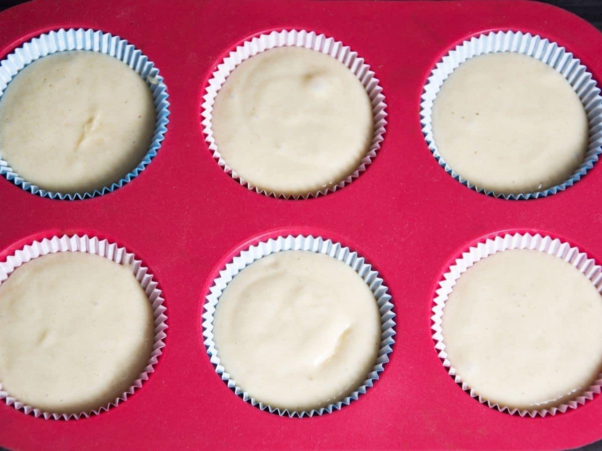 muffin batter in a muffin tin