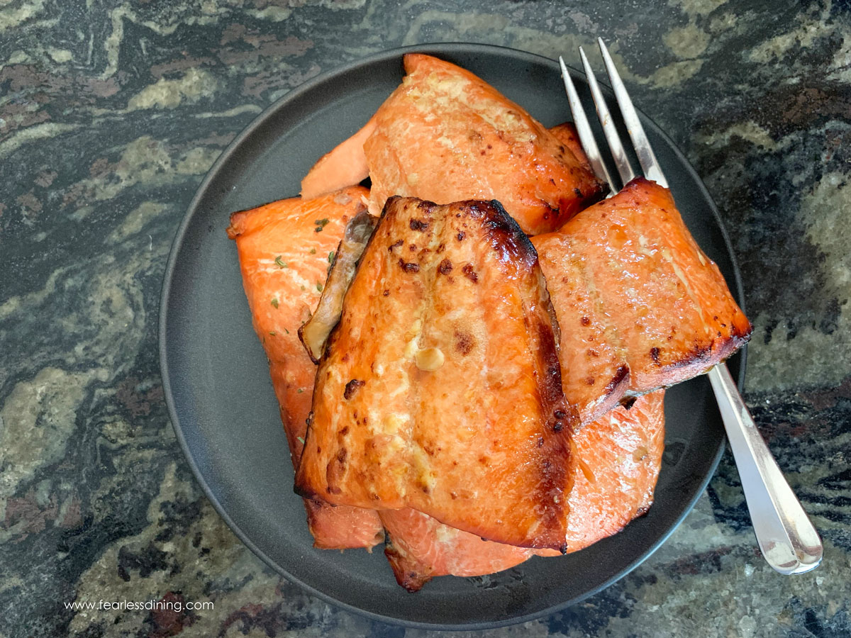 a plate full of cooked salmon