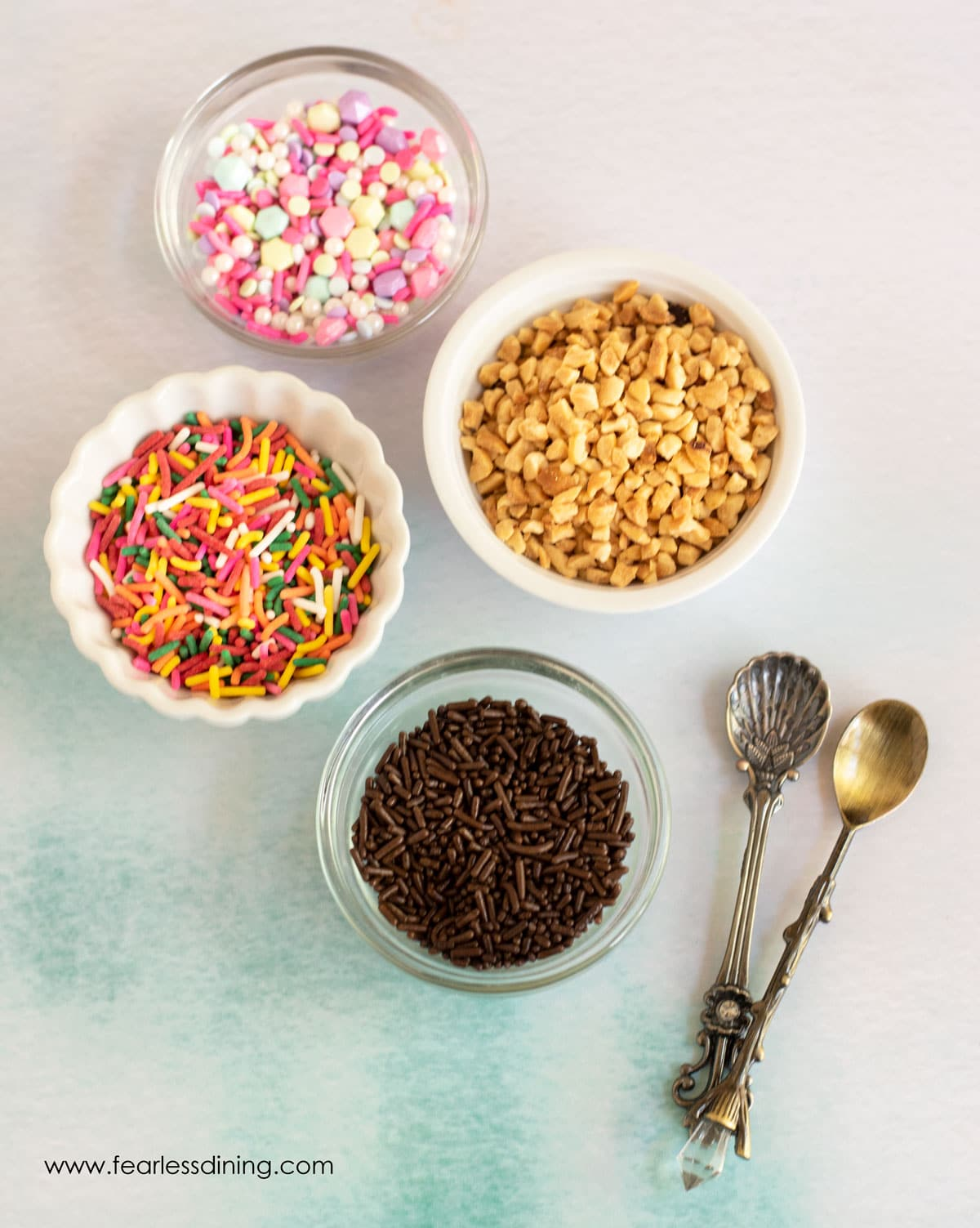 toppings bar with dishes of sprinkles and chopped nuts