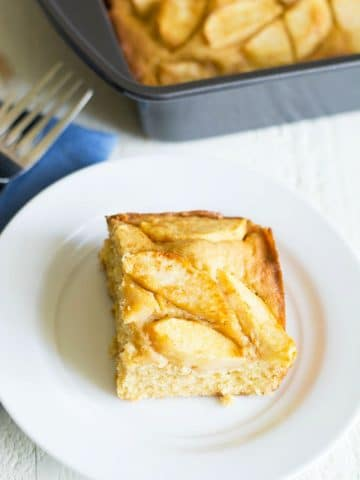 a slice of gluten free German apple cake on a small white plate