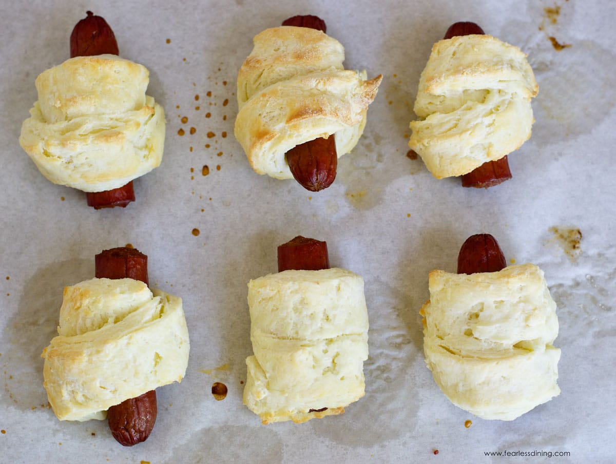 baked pigs in blankets on a cookie sheet