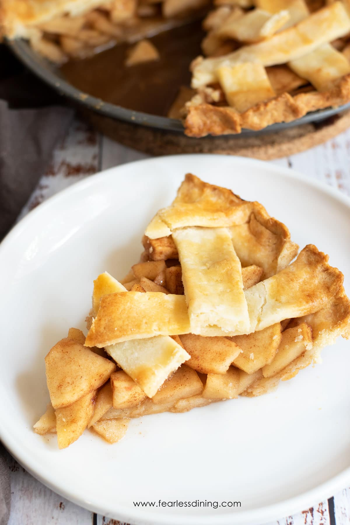 a slice of apple pie with a lattice crust on a plate