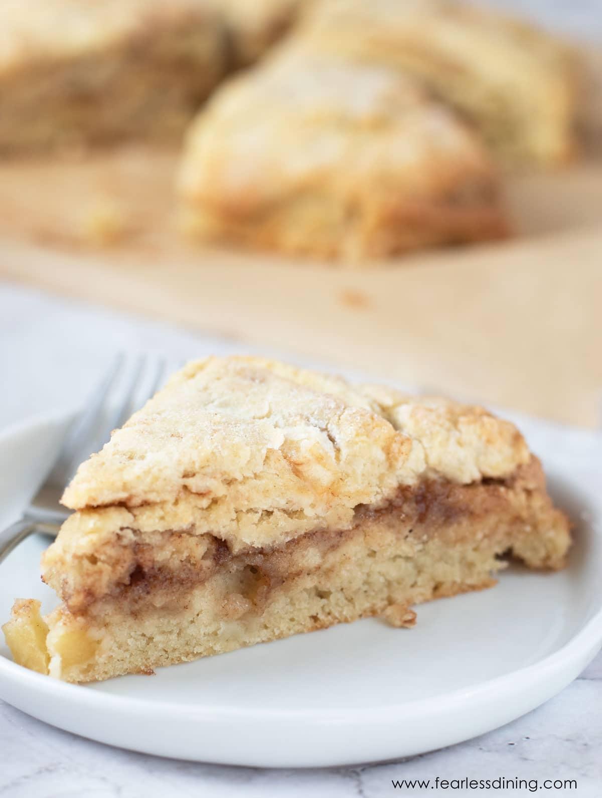 a gluten free cinnamon apple scone on a white plate