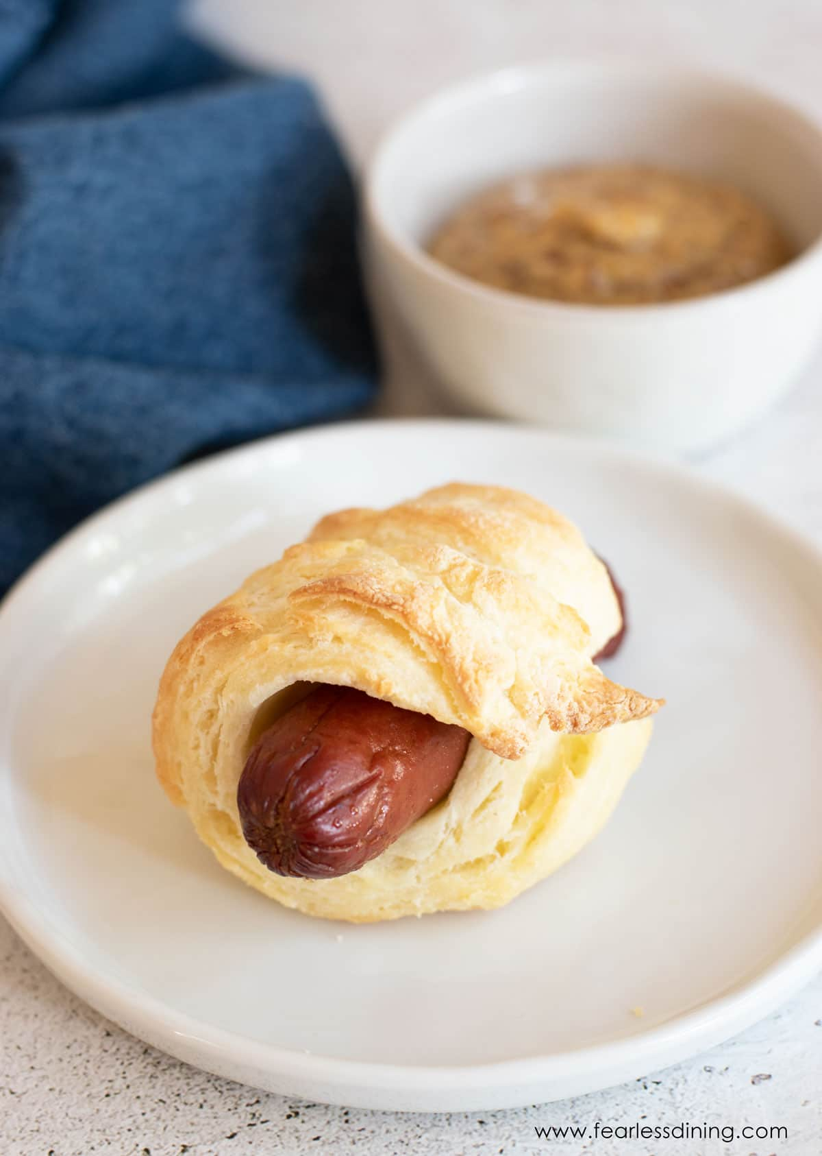 a gluten free pig in a blanket on a plate
