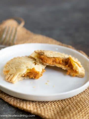 a gluten free hand pie cut in half on a plate