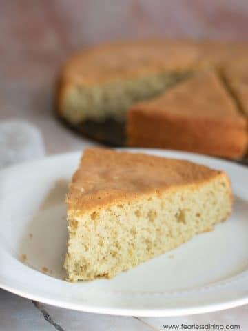 a slice of gluten free sponge cake on a white plate