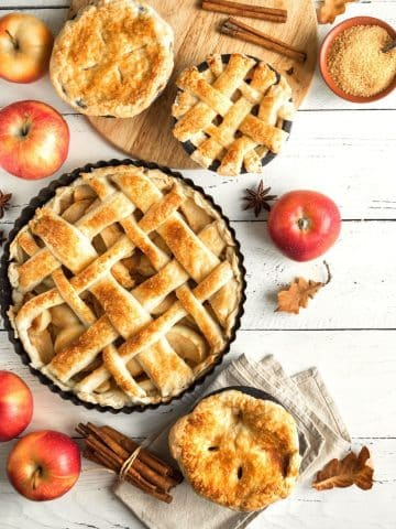 lots of pies with apples and spices on a tale