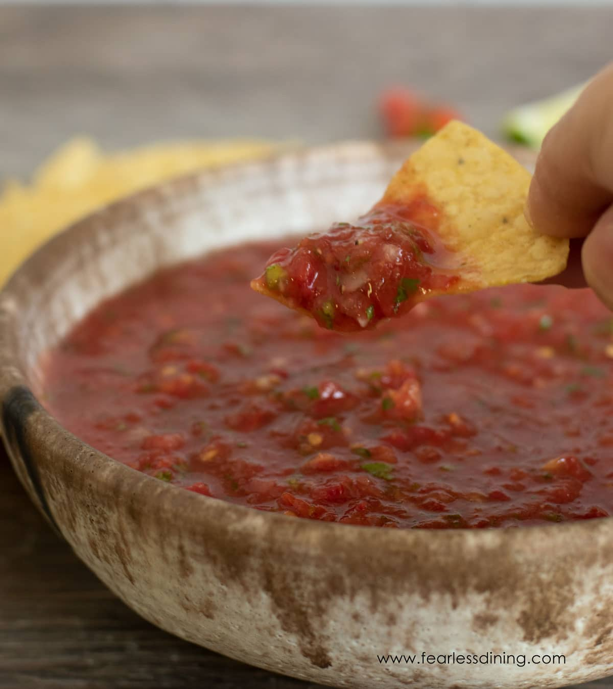a chip full of salsa