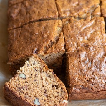 square slices of gluten free banana cake on a cutting board