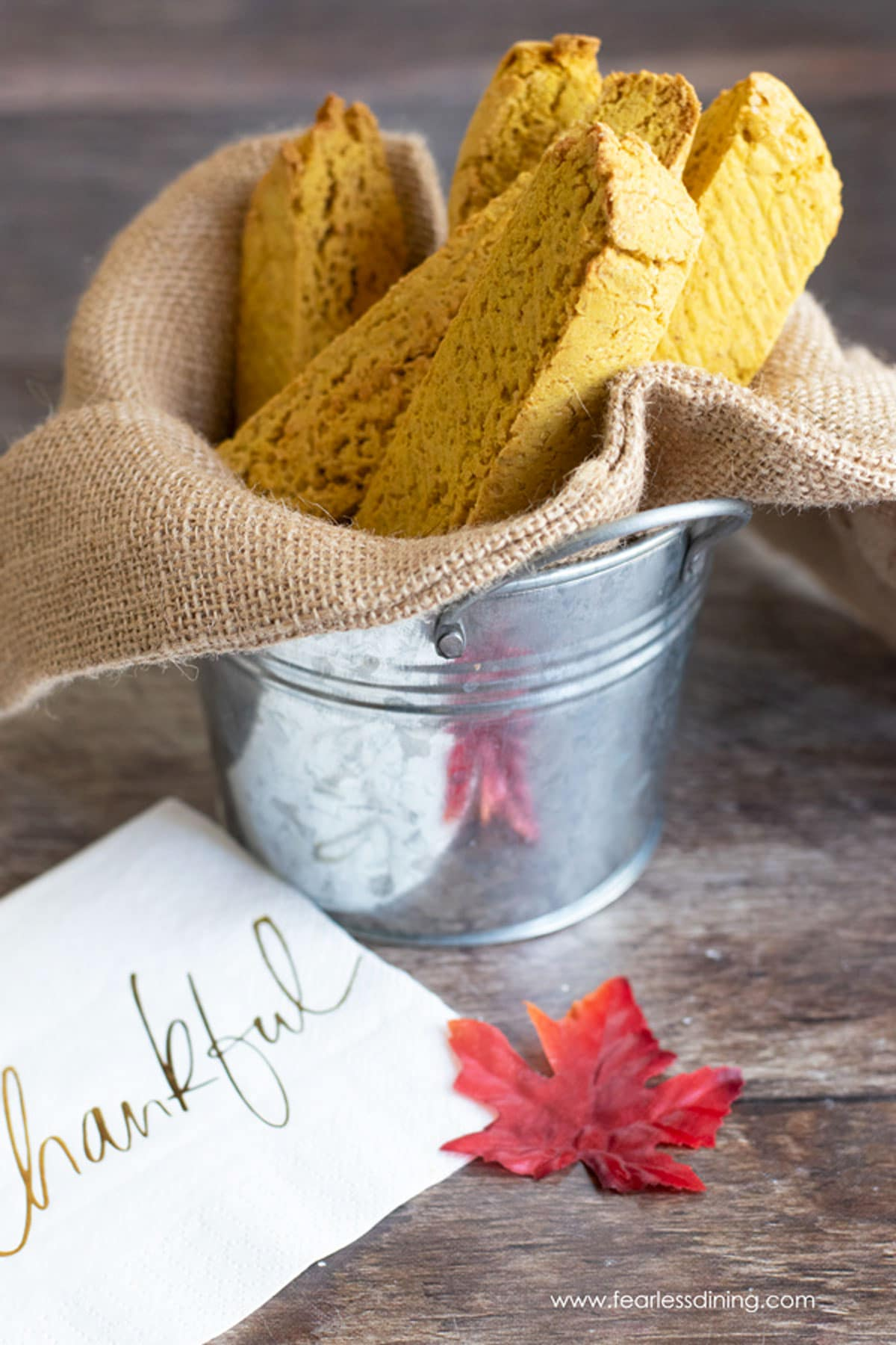 gluten free pumpkin biscotti in a silver pail serving container