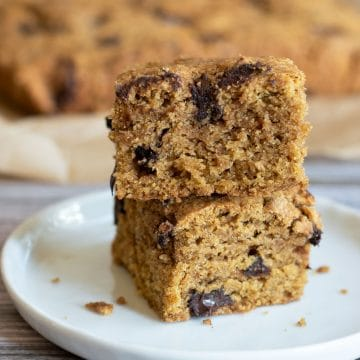 a stack of two gluten free pumpkin cake bars on a plate