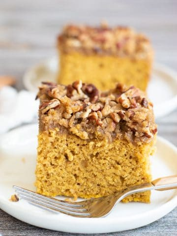 two slices of pumpkin coffee cake on white plates