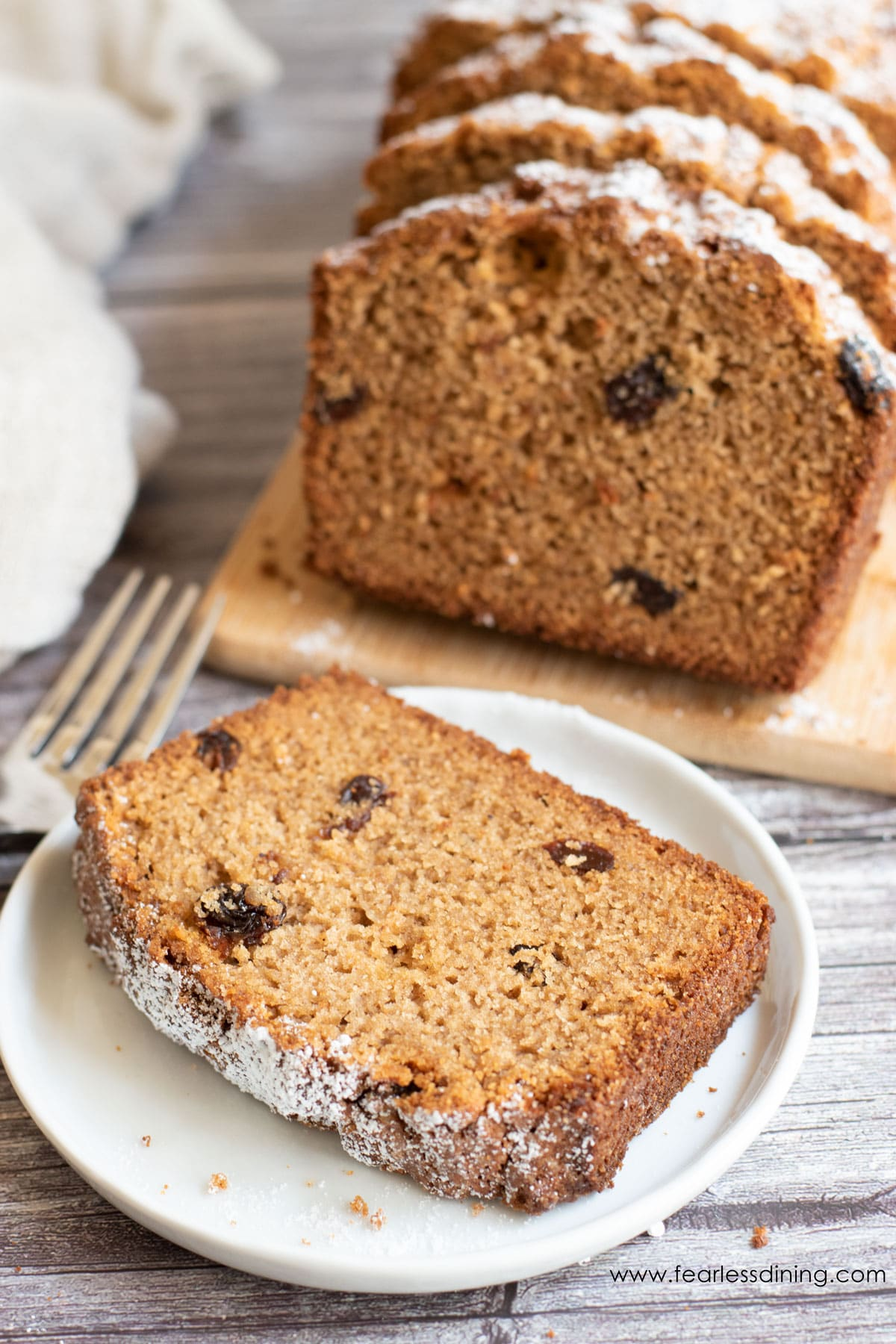 a slice of gluten free spice cake on a white plate