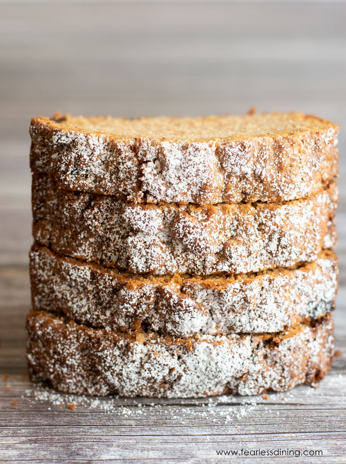 a stack of four slices of gluten free spice cake