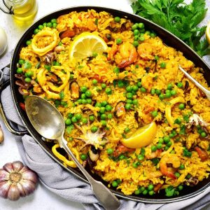 a pan full of paella on a table