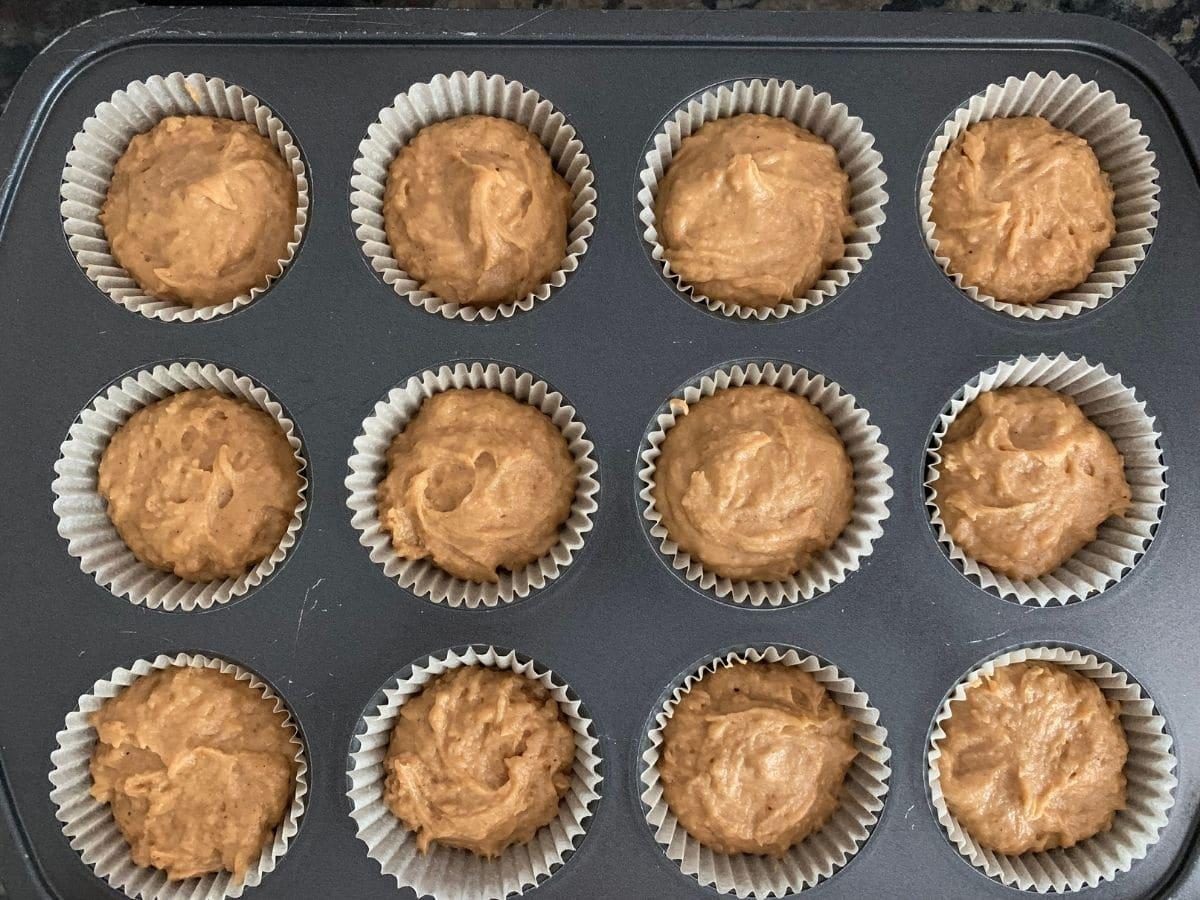 cupcake batter in muffin tin ready to bake