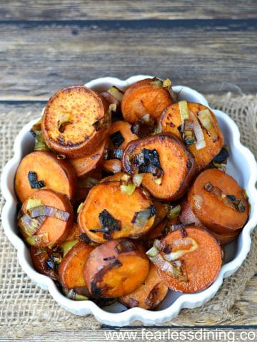 a white bowl filled with pan-fried sweet potato slices